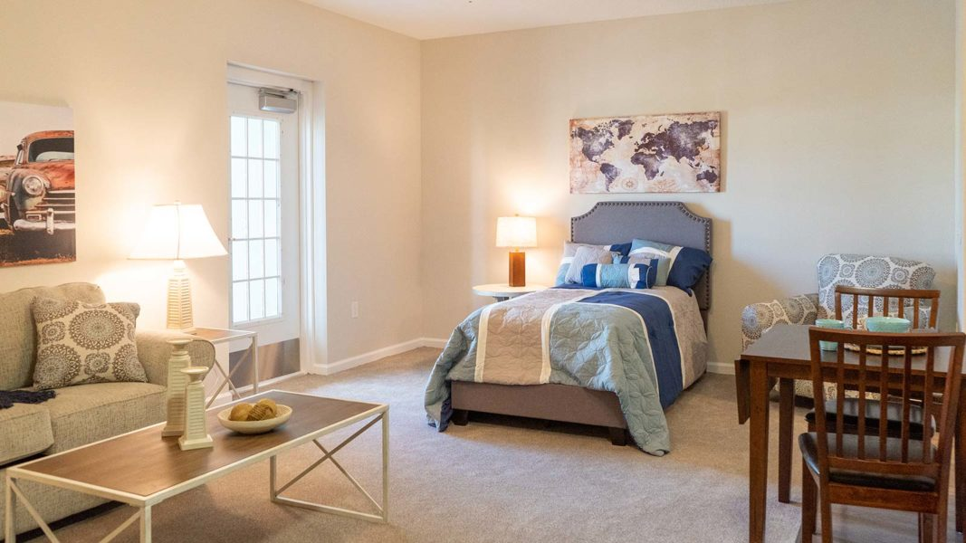 Assisted Living Studio Apartment With Bed, Living Area And Eat-in Kitchenette